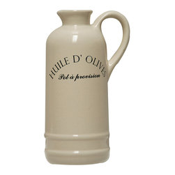 Huile D'Olive (Olive Oil) Pitcher - Tall, lean, and utterly classic, the Huile d'Olive Pitcher is excellent for portioning out the olive oil its chic French script promises, but it can also be used as an unconventional serving piece for your trademark vinaigrette or simply as a handsome, eclectic vase for an armful of just-picked wildflowers. The simple, handsome design includes domed shoulders and a high handle.