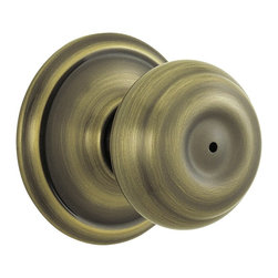 Schlage - Georgian Antique Brass Bed and Bath Knob - F4 - Manufacturer SKU: F40 GEO 609. Handle Type: Knob. Use on a 1-3/8 in. to 1-3/4 in. thick door. Universal latch and Triple Option faceplate fit standard door preparations. Privacy knob, with push-button lock, for use on an interior bathroom or bedroom door. All-metal chassis for durability. Antique brass finish. Includes hardware for quick, 1-tool installation. Includes unlocking tool. ANSI Grade 2. Finish: Antique Brass. 2.1 in. L x 2.8 in. W x 2.8 in. H (1.1 lbs)