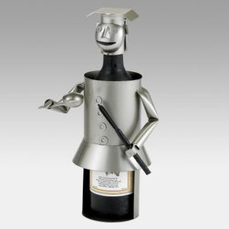 "Chef Wine Bottle Buddy - What goes together better than food and wine? Maybe a bottle of wine and the Chef Wine Bottle Buddy an accent or gift item for lovers of wine and fine food. It holds one 750ml wine bottle or any similar size bottle of craft beer or olive oil. It makes a fabulous gift for the head of the kitchen.The Old Dutch Bottle Buddy series is a collection of light-hearted hand-made bottle holders to add some artistic whimsy to your two passions. Each Bottle Buddy is made of solid steel with silver and matte black finish accents. Every Bottle Buddy ships with a handsome bottle of Old Dutch """"Faux Merlot """" which you can replace with your own favorite wine. What will Old Dutch cook up next?About Old Dutch InternationalFamous for their copperware Old Dutch International Ltd. has been supplying the best in imported housewares and giftware to fine retailers throughout America since 1950. They offer a large assortment of housewares including bakers racks trivets and pot racks in materials like chrome colorful enamel and stainless steel. Other product lines include wine racks serving trays specialty cookware clocks and other home accessories. Old Dutch warehouses and distributes their products from a 30 000 square foot facility in Saddle Brook N.J."