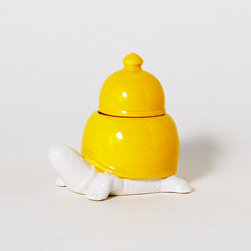 Hero in a Half-Shell Container - Endearing and colorful, this porcelain turtle container is ripe with storage opportunity: keep it stocked with sugar for your morning coffee, use it as a safe haven for special jewelry, or use it as a change jar. Brilliantly yellow and totally cute, this container is an easy way to bring warm energy into your home.