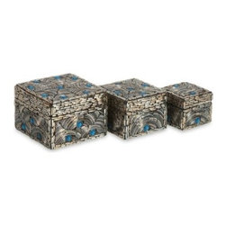 IMAX Peacock Bangle Boxes - Set of 3 - The IMAX Peacock Bangle Boxes - Set of 3 adds exotic flair to your space via jewel-toned glass cut and arranged in a mosaic pattern to resemble peacock feathers. This set of three decorative boxes, handcrafted from Native American bangle bracelets, shimmers with distinctive silver and blue, bold enough to enhance modern and traditional decors alike. Sized perfectly for cherished trinkets of any kind, from jewelry to jingle bells, these tabletop boxes are treasures unto themselves.About IMAXWhat began as a small company importing copper flower containers in 1984 by Al and Faye Bulak has developed into one of the top U.S. import companies serving the At Home market today. IMAX now provides home and garden accessories imported from twelve countries around the world, housed in a 500,000 square foot distribution center. Additional sourcing, product development and showroom facilities in the USA, India and China make IMAX a true global source. They're dedicated to providing products designed to meet your needs. This is achieved through a design and product development team that pushes creativity, taste and fashion trends - layering styles, periods, textures, and regions of the world - to create a visually delightful and meaningful environment. At IMAX, they believe style, integrity, and great design can make living easier.