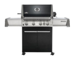 "Napoleon Prestige P500RB Grill with Rear Burner - Black - The product specialists at Hayneedle have been extensively trained by the manufacturer of Napoleon grills. These specialists know the product inside and out top to bottom front to back. They're here to help you with every step of your Napoleon grill purchasing process. Learn everything you need to know as you customize your grill island with drawers doors pizza ovens and more! Call 866-579-5183 to speak with a product specialist and start building your dream grill island today. Hours: Monday-Friday 9 a.m.-7 p.m. E.T. The Napoleon Prestige P500RB Grill with Rear Burner Black Doors elegantly blends form and high-performance function with top-of-the-line components and a sleek black finish. Producing 66 000 BTUs across 760 square inches of cooking surface this top-of-the-line grill can also use infrared technology to save you time and money on fuel costs while cooking meat faster and more evenly. It also features an enclosed cabinet and stainless steel construction from its roll-top lid to the heavy-duty casters that provide maximum mobility. Porcelainized cast iron reversible cooking grids sit atop steel commercial grade tube burners powered by a JET FIRE ignition system. Includes side shelves for setting aside plates grilling tools and the next few shrimp for your barbecue. Additional Information LIFT EASE stainless steel roll top lid with cast aluminum """"no-rust sides"""" that allow zero-clearance installation from the rear EASY-SET ergonomic knobs that connect to precision brass valves and JET FIRE independent electronic burner ignition Stainless steel side shelves with full-width CONTOUR condiment trays Burners positioned front to back for exact heat control and independent grilling zone use. Choose direct cooking to broil your food or indirect cooking for an oven-like experience. Porcelainized cast iron WAVE reversible-channel cooking grid hold drippings to keep food juicy Patented stainless steel sear plates easily control flare-ups and protect the 304 stainless steel burners Infrared rear rotisserie burner for sealing in juices Full-width removable drip pan and grease cup Full LIFETIME warranty included About Napoleon GrillsRising up from its humble beginnings in Barrie Ontario Canada Napoleon Gourmet Grills has become North America's largest privately owned manufacturer of top-of-the-line wood and gas fireplaces gourmet gas and charcoal grills waterfalls and outdoor living products. It all started 1976 when Wolfgang Schroeter started manufacturing steel railings. His designs proved to be a great success and soon enough he was producing an original stove with a solid cast iron two-door design in a 1 000 square foot facility. And over the past 30 years his company Wolf Steel Ltd's dedication to innovative patented technology has lead to the exclusive infrared grilling experience and two new departments: Napoleon Fireplaces and of course Napleon Gourmet Grills. Today this company operates with over 500 000 square feet and over four-hundred hard workers in its employ."