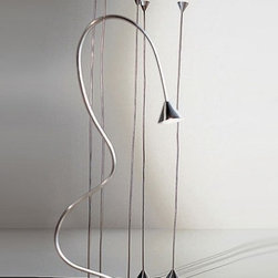 """Pallucco - Pallucco Papiro floor lamp - The Papiro floor lamp from Pallucco has been designed by Sergio Calatroni in 1988. This floor mounted luminaire is great for halogen lighting. The Papiro is composed of a directable, slinky design that is available in a variety of finish options: copper, nickel, gloss black and pearl gold. The Papiro floor lamp combines versatility and ingenuity, along with quality craftsmanship, that is sure to brilliantly illuminate any contemporary domain.  Product Details:  The Papiro floor lamp from Pallucco has been designed by Sergio Calatroni in 1988. This floor mounted luminaire is great for halogen lighting. The Papiro is composed of a directable, slinky design that is available in a variety of finish options: copper, nickel, gloss black and pearl gold. The Papiro floor lamp combines versatility and ingenuity, along with quality craftsmanship, that is sure to brilliantly illuminate any contemporary domain. Details:                                     Manufacturer:                                      Pallucco                                                     Designer:                                     Sergio Calatroni                                                     Made in:                                     Italy                                                     Dimensions:                                      Small: Height: 86.6"""" (220 cm) Width: 6.1"""" (15.5 cm)                          Large: Height: 106.3"""" (270 cm) Width: 6.1"""" (15.5 cm)                                                                                                                  Light bulb:                                      Small and Large: 1 X 75W halogen                                                     Material:                                      Metal"""