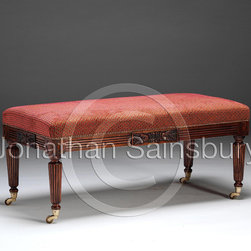 Regency Oak Leaf Stool - A finely carved and reeded mahogany stool, with a central panel of oak leaves and quatrefoil corner paterae, on brass casters.