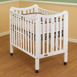Orbelle Tian Two Level Portable Crib - White - There are many thrilling adventures to be had by you and your baby out in the big, wide world - if only you can find a good away-from-home sleeping solution like the Orbelle Tian Two Level Portable Crib - White. The crib is easy to assemble (tools included), easy to set up and take down, and easy to change from crib to playpen or changing table without tools. When you have one of these cribs, you just can't stop saying easy. It comes with its own mattress - makes it easy for you, since you don't have to go buy one. It folds flat, for - you guessed it - easy storage. And it's lightweight, which makes traveling easy, too. There is more to this crib's personality, though. It is finished beautifully, with a unique and stylish curved top, and it's as safe as can be, with two stationary sides and fully-hooded casters (two can be locked). It's the only portable crib on the market with a two-level design. Don't you think you should click the Add to Cart button and get the shipping process started, so you can begin your adventures soon? About Orbelle TradeBegun in Brooklyn, NY, in 1991, Orbelle has grown into a leading baby and teen furniture business, still family owned and operated. Fast shipping and quality furniture with exclusive designs and colors keep Orbelle at the forefront of baby and kids lines of furniture.