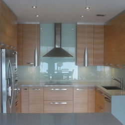 modern kitchens - custom made cabinets, and custom made countertops.