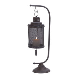 "Lantern with A Disserted Finish with Tall Holder - Unique and elegant, the Metal Lantern 28""H, 8""W flaunts an extraordinary look and is perfect for sprucing simple room settings. Lavished with a distressed finish, he charming design of this lantern is perfect for decorating the mantle area or can be used in the study to lend a warm, welcoming feel to interiors. The sturdy base of this lamp offers optimum space to carefully place a short, wide candle. Elaborately detailed with an intricate metal mesh screen, the light from the lantern casts an enchanting glow and is sure to garner attention. This fine lantern is hung from a slender metal holder that has a sturdy, carved base to ensure optimum support added safety. Impeccably designed from premium grade metal, this lantern ensures lasting performance due to its robust construction.. It comes with following dimensions"