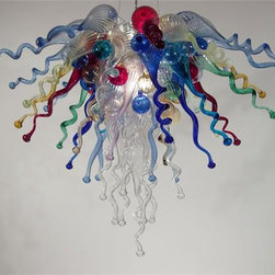 "Red Fern Glass - Blown Glass Chandelier 452 - This carnival of a chandelier is made of 86 hand blown glass pieces in the "" Knobby Curly"" form. Glass colors include Cobalt, Light Cobalt, Near Clear, Light Blue and Red.  Chandeliers are also available without lighting, call for pricing.   Note- These exquisite designs are very diverse, and can be custom made to perfect any project.     Handcrafted in USA! Note- This fixture ships in 4-6 weeks.  Note- Colors shape and size can all be modified specifically for your design needs. See image 2 for color chart. Please call for pricing and more details.        Please note that the price listed pertains to a fixture that will appear very similar to the light shown in the featured photograph and as outlined in the accompanying description.  Virtually all of our artisan crafted fixtures can be customized regarding size, shape, and / or color(s).  Please call for details."