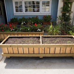 """Rolling Planters M28 (2 x 7.5' x 25"""") - Developed to allow people to grow healthy organic produce at home and provide a means to partially reduce our carbon foot print.    Each planter allows plants to easily follow the sun and allow flat hardscapes to be used for multiple purposes.   Taller planters are offered for those with chronic back problems or other physical limitations and handicaps (up to 42"""" tall)."""