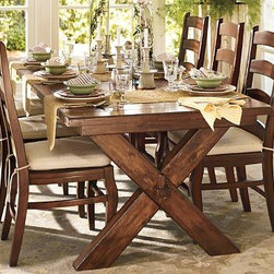 """Toscana Extending Dining Table, 88.5 x 40"""" Tuscan Chestnut stain - Our Toscana trestle table evokes a 19th-century Northern Italian tailor's table with its X-shaped supports, keyed through-tenons and warm Tuscan Chestnut finish. It's crafted with a planked top and eased edges, and designed to maximize legroom and serving space. Two breadboard leaves drop in seamlessly at either end, making the table ideal for large gatherings. 88.5"""" long x 40"""" wide x 30"""" high; extends to 124.5"""", comfortably accommodating up to 10 Handcrafted with a kiln-dried wood frame. The Tuscan chestnut finish is a 14-step process with hand-applied layers, hand distressing and burnished edges that give the table the look of a well-loved antique. The coordinating bench spans the entire length of the table, comfortably seating three. Wood swatches, below, are available for $25 each. We will provide a merchandise refund for wood swatches if they're returned within 30 days. View our {{link path='pages/popups/fb-dining.html' class='popup' width='480' height='300'}}Furniture Brochure{{/link}}."""