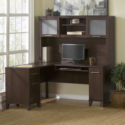 Bush Furniture - Bush Somerset L-Shaped 60 in. Computer Desk with Optional Hutch - BHI1348 - Shop for Desks from Hayneedle.com! L is for landing every pitch and promotion from behind the Bush Somerset L-Shaped 60 in. Computer Desk with Optional Hutch's spacious worktop. Crafted with durable thermally fused wood laminate finished in a rich mocha cherry hue this L-shaped computer desk can come crowned with a hutch if you opt to include both pieces. With or without the hutch the desk boasts pedestals that conveniently can mount to either the left or the right side featuring a box and a letter-size file drawer that both slide smoothly on ball-bearings. A tall CPU compartment reduces cord and component clutter with rear wire access. The optional hutch adds open and enclosed storage open cubby spaces for books and photos and cabinet space fronted by frosted glass doors. Brushed nickel hardware throughout is a cool finish.DimensionsOverall desk dimensions: 59.25W x 59.25D x 29.25H in.Hutch: 59.09W x 13.7D x 35.69H in.About Bush FurnitureBush Furniture is the eighth largest furniture company in the United States. Bush manufactures high-quality products which are designed to be easily assembled and provide great value for the price. Bush furniture is made from a combination of particleboard fiberboard and solid wood components. The use of real wood components will be noted in the product description if applicable.Bush Industries has over 4 000 000 total square feet of manufacturing warehousing and distribution space. This allows for a very wide selection of high-quality furniture with the ability to ship quickly. All standard residential Bush products carry a generous 6-year warranty. All Bush business furniture including the A series C series and Quantum series is backed by a 10-year warranty from Bush one of the best in the industry.