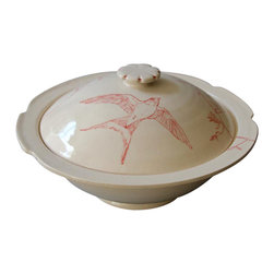 Bird Casserole - This is a truly special piece. Clean and simple lines, the covered dish would be an exquisite item on any dining table. Hand painted with a bold, red line drawing, it is entirely unique and one of a kind.  The intricately detailed bird in flight is delicate yet bold and and would wow any guest as it served a stew, casserole or pasta dish.  This is one of a kind, and a beautiful piece.