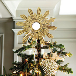 "Ballard Designs - Venetian Tree Topper - Burnished gold finish. 2"" Wire spiral on back attaches to tree. The staggered rays of our Venetian Tree Topper are crafted of layered tin and hand finished in a multi-step French tole process for rich 3-dimensional texture. The center mirror catches the light, creating a dramatic focal point crowning your tree.Venetian Tree Topper features: . ."