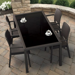 Compamia - Compamia Miami Resin Wicker Rectangle Patio Dining Set with Optional Cushions - - Shop for Tables and Chairs Sets from Hayneedle.com! Don't miss a single opportunity for the simple luxury of outdoor dining when you can step out your door to the Compamia Miami Resin Wicker Rectangle Patio Dining Set with Optional Cushions. This durable set starts with frames of weatherproof resin that's covered in appealing resin wicker. Resin wicker gives you the feel and visual style of traditional wicker without forcing you to watch your wicker slowly degrade to moisture UV-exposure and weathering. The table has legs of corrosion-resistant aluminum and a single sheet of dark-tinted glass inset into the table top.About the optional cushions:Fade- and stain-resistant Sunbrella fabric Filled with high density foam wrapped in Dacron Washable cushion covers are zippered and feature welted trim Your choice of colors About CompamiaAs a highly selective distributor of weatherproof functional and comfortable furnishings for residential and commercial settings Compamia is proud to provide resin furniture that's comfortable luxurious and durable. Compamia works with restaurant suppliers hoteliers and restaurateurs to provide furnishings to withstand heavy use in the most upscale locations and the most challenging climates. Since 2002 Compamia has enjoyed operating from sunny Miami FL. As a wholesale distributor of luxury commercial-grade outdoor furnishings Compamia is where materials technology and design come together to satisfy our customers' most exacting standards.