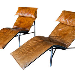 Tord Bjorklund Chaise Longues - I think the chaise lounge is sexy, but these 1970 Swedish beauties are a tad masculine. But sexiness is a two-way street, right? They are covered in a beautiful old leather, and because there are two, it might be fun to share some his-and-her time together relaxing on them.