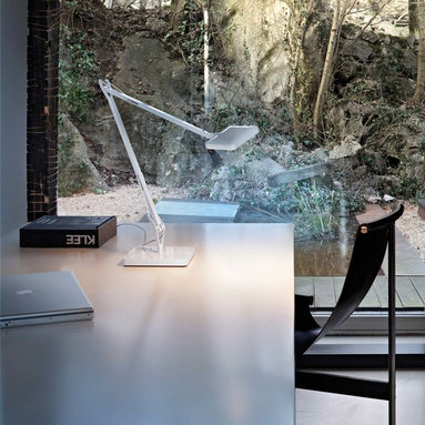 Flos - 2. FLOS Kelvin LED Table Lamp - The Kelvin LED Desk Lamp from FLOS provides an ample spread of direct light in a thoughtfully engineered, energy efficient design. Features a double pantograph arm and swiveling head. Toggle the light on/off by lightly touching the sensor once for maximum light, again for a minimum illumination at 70% and a third time to turn the unit off again.