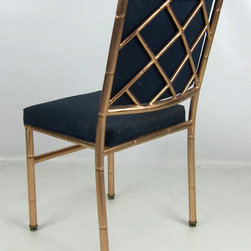 Brass Chippendale-Style Side Chairs - This Chippendale-style chair got a rare makeover in faux bamboo with a solid brass frame. Every room needs an accent chair, and this fills up that empty corner. I would re-upholster this in a bright pink tropical floral print or even a wild animal pattern for maximum impact.