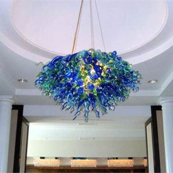 Belle Meade Hot Glass - Sofitel Chandelier - This chic chandelier is shown in vibrant colors of Emerald, Aqua, and Cobalt. individually hand blown glass pieces are a mixture of shapes found in nature: Pods, Horns and Gourds (see additional photo #3). Note- This is a representational item that can be commissioned. These designs are very diverse and can be custom made to fit any project. Other colors, sizes, and shapes are available so please call for more details. Allow us to help turn your vision into a reality. Note- This chandelier is lit from within the armature by easily replaceable 75 watt halogen bayonet bulbs. The lighting system is made from UL listed parts. The armature is shaped appropriate to the chandelier. Note- These chandeliers are suspended by a thin, high strength cable, the length of which must be specified when ordering. The weight for these chandeliers averages 30 pounds per 50 pieces. Due to the many different styles and types available, a ceiling canopy is not provided but can easily be obtained through your electrician. Note- If this item will be viewed from above, such as in a stairwell, the top will need additional pieces covering the armature at additional cost. Please call us for a price quote and specify this when ordering.  LED and Compact Fluorescent lighting are both available. Call for details.  Please note that the price listed pertains to a fixture that will appear very similar to the light shown in the featured photograph and as outlined in the accompanying description.  Virtually all of our artisan crafted fixtures can be customized regarding size, shape, and / or color(s).  Please call for details.