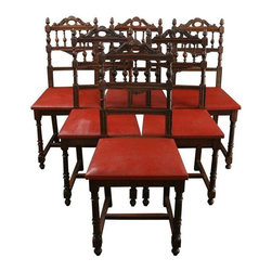 """Used 1920s French Renaissance Dining Chairs - Set of 6 - Say """"bonjour"""" to this delightful set of six antique dining chairs from France. Dating back to 1920 and carved in the Renaissance or Henry II style, these cafe size chairs evoke images of a traditional Paris bistro. The square seats are upholstered in red faux leather to give a great pop of color and the beautifully carved crest rail creates a distinctive silhouette on these antique French chairs.    Overall Condition is Good. A piece of back splat is missing on one chair. Springs may need to be retied. Shows normal wear to the finish and miscellaneous nicks, dings, and scratches due to age and use. Seat height is 19.50"""" H."""