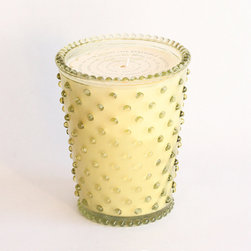 Frontgate - Simpatico Fir & Purplefruit Hobnail Candle - Hand-poured. 100% vegetable wax blend is sourced from vegetables grown by American farmers. Long-lasting burn time of approximately 80 hours. Lead-free cotton wick. Hobnail glass can be reused as a vase. Candlelight gleaming through a lovely, colored, pressed-hobnail glass is enhanced by a gorgeous, nature-inspired scent in this Simpatico Fir and Grapefruit Hobnail Candle. Scented with natural fir oils and grapefruit, this is an amazing and unlikely combination.  .  .  .  .  . Made in the USA.
