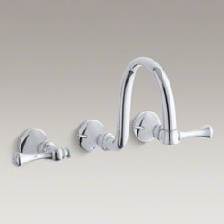 KOHLER - KOHLER Revival(R) wall-mount bathroom sink faucet trim with traditional lever ha - Blending European style and early American influences, Revival faucets and accessories bring continuity to your bathroom design. This bathroom sink faucet trim features a gracefully arched spout and traditional-style lever handles in a space-saving wall-mount design--an elegant choice for vessel sinks or sinks without faucet holes. Pair this trim with a two-handle ceramic disc valve for optimal performance.