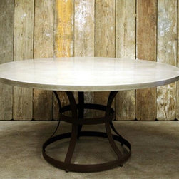 James De Wulf Hourglass Dining Table - I love the sleek concrete top and the metal base on this table. It's modern with a farmhouse flair.