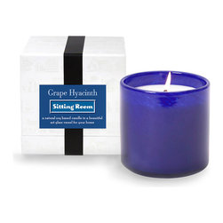 House and Home Grape Hyacinth / Sitting Room Candle - The brilliant blue of this candle cup whispers of spring blooms vividly come to life beneath the welcome warmth of the season's sun. The House and Home Grape Hyacinth/Sitting Room Candle presents a delicate floral scent that suggests a mix of lemon thyme and grape hyacinth. The airy fragrance is ideal for adding a whisper of the garden to a sitting room, master suite, or bath.