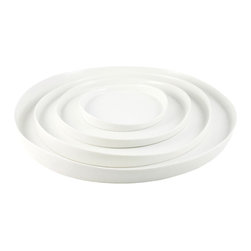 Ripple Porcelain Trays, White - I love the round, organic shape of the plates in this set. Each plate looks great individually, or stack a couple for more visual impact.
