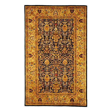 Safavieh - Hand-Tufted Blue and Gold Rug (2 ft. 6 in. x 4 ft. Runner) - Choose Size: 2 ft. 6 in. x 4 ft. Runner. Hand Tufted. Made of Wool. Made in India. Inspired by the legendary designs of Persia's most prestigious rug-weaving capitals, these extraordinary reproductions recreate some of the most prized antiques in Safavieh's archival collection. Intricate Tabriz, Lavar Kerman and Isfahan hand-knotted motifs are remarkably adapted to these hand-tufted rugs of incomparable quality. The finest New Zealand wool is chosen to achieve the intricate weave of these carpets. With utmost attention to every detail, Safavieh creates its Persian Legends Collection in India to provide consumers an exquisite yet affordable artisan-crafted look.