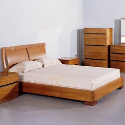 """Hokku Designs - Maya Platform Bedroom Collection - Features: -Maya collection. -Teak finish. -Solid wood and veneer construction on medium density fiberboard. -Curved headboard. -Platform slats system for mattress support. -Sunken mattress placement. -Offers excellent workmanship in a contemporary package. -Full extension ball-bearing tracks for all drawers. -Manufacturer provides one year warranty. -Please Note: Box spring ships separately from bedroom furniture, and may arrive for delivery on an earlier or later date than bedroom furniture . Specifications: -Full size bed dimensions: 38"""" H x 82"""" W x 59"""" D. -Queen size bed dimensions: 38"""" H x 87"""" W x 65"""" D. -King size bed dimensions: 38"""" H x 87"""" W x 83"""" D."""