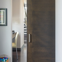 Mid2Mod -- A Trendspotting Guide to Interior and Exterior DOORS - StileLine by Lynden Door, in rift white oak with a dark stain and barn door hardware.