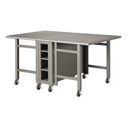 Martha Stewart Living Craft Space Collapsible Craft Table - This is my favorite table in the whole house! It's easy to move around thanks to the wheels, and it can be folded up against the wall in the craft/guest room when not in use. My kids also use it for school projects and homework.