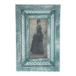 Oriental Furniture - Rustic Bustled Lady Framed Picture - Printed gray scale drawing of a woman in a Victorian period bustle dress. Wide wood frame has a band of pierced metal filigree inset, finished in teal paint with a distressed white overcoat. Mounting hardware installed on the back of frame. Artwork is protected by a durable Plexiglass panel, and held into place with the back panel via tight C clips screwed into the frame.