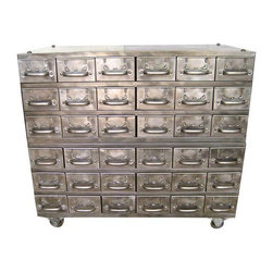 """Used Vintage Industrial Steel Cabinet - A vintage thirty-six drawer industrial steel cabinet on wheels, that has been stripped and mirror polished. Each individual drawer measures 5.5"""" wide by 3.5"""" tall. Manufacturer is Equipto from Aurora, Il and the vendor hallmarks are still on the side of cabinet."""