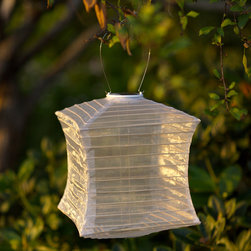 Allsop Pagoda Solar Pearl Lantern - Bring a touch of Asian elegance to your backyard or garden with these Pagoda Solar Lanterns. These beautiful lanterns combine shimmering, sheer silk fabric in sophisticated earthy colors with a traditional Asian lantern shape. Designed for outdoor use, these solar powered lanterns collect light all day and turn themselves on at dusk. Each lantern is equipped with dual white high powered LED lights, solar panel, AAA rechargeable solar battery and stainless steel hardware that is easy to assemble. Make every evening in your garden festive with this beautiful handmade lantern. Available colors: Bronze, Moss, Pearl, and Slate. Dimensions: 10Wx10Dx12H.