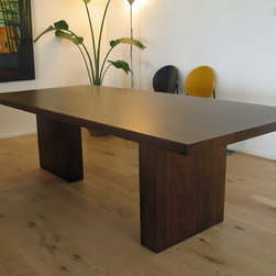 Large Dinning Tables - This table is made from solid Black Walnut.  The design was inspired from a grainy photo in some magazine.  It is solid, clean-lined and contemporary.