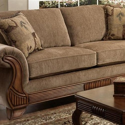 Chelsea Home - Glendale Upholstered Sofa - Includes two toss pillows. Sofa with traveler havana cover. Pillows with botany cover. Seating comfort: Medium. Kiln-dried hardwood frame. Stress points are reinforced with blocks to secure long lasting frame. Sinuous springing system manufactured with reinforced 16-gauge border wire. Double springs are used on the ends nearest the arms to give balance in the seating. Hi-density foam cores with dacron polyester wrap cushions. Cushions made with zippers. Made from 100% polyurethane. Made in USA. No assembly required. 96 in. L x 40 in. W x 41 in. H (125 lbs.)