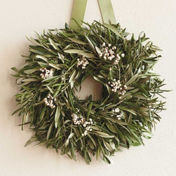"Viva Terra - Olive Wreath - The olive wreath has come downthrough the ages to symbolizeperfect form and endurance.Ours is accented withwhite tallow berries.WREATH 16""DIAM, HANGER 13""L"