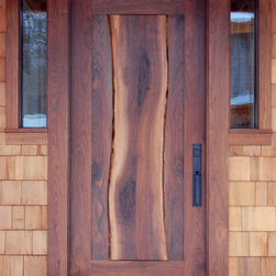 NEWwoodworks Live Edge Fine Woodworking - A thick walnut slab, complete with live edges, flows down the center of the entry door on Dan and Beth's home in New York.