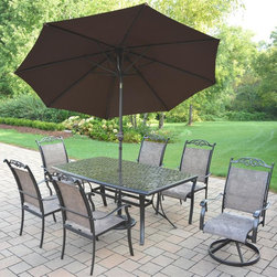 Oakland Living - 9-Pc Outdoor Dining Set - Includes dining table, four dining chairs, two swivel rockers 9 ft. tilt crank umbrella with stand and metal hardware. Fade, chip and crack resistant. Durable, handcast and rust free. Traditional lattice pattern and scroll work. Hardened powder coat. Warranty: One year limited. Made from cast aluminum and sling. Coffee color. Minimal assembly required. Table: 70 in. L x 38 in. W x 29 in. H. Dining chair: 24 in. W x 30.5 in. D x 40 in. H (12 lbs.)The Oakland Cascade Collection combines contemporary style and modern designs giving you a rich addition to any outdoor setting.