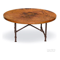 "Mathews & Company - Burlington Coffee Table with 42"" Round Top - Burlington Coffee Table is a classic wrought iron coffee table that will work well for any interior. This table comes with a sturdy wrought iron base that has been hand forged to perfection by skilled artisans to ensure a long lasting piece that will grace your living room for the years to come. The solid wooden top is sturdy and visually appealing thanks to the Old World Pine finish, and adds to the classic grace of this table. You can also order this table with a round copper top or a glass top for a trendier look. You can also order this table with Red Marble-scolloped Edges. The base has been fashioned from pipe like legs and has an X-shaped support beneath the top. Classic matte black finish will work for any interior. You can also opt for a different finish option like Aged Rust, Aged Bronze and Aged Pewter to match your interior. You can also order this lovely table as a base only and use it with an existing top. Pictured in Copper top and Aged Rust finish."