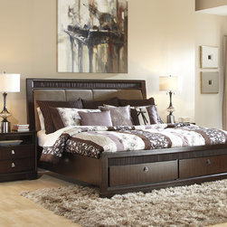 Signature Design by Ashley - Signature Design by Ashley Marxmir Medium Brown Upholstered Bed - Add a touch of lavish style to your bedroom with the beautifully designed Marxmir upholstered bed. Crafted with smooth medium brown finish,this bed  this bed is completed by storage drawers in the footboard.