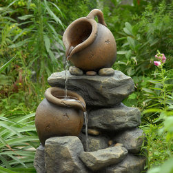 None - Small Pots Water Fountain - This small fountain features three levels of pouring water. Water gently cascades from one jar top to the next and ultimately pools into the bottom of this elegant electric fountain.