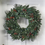 "Frontgate - Classic Pre-lit Christmas Wreath Christmas Decor - The garlands measure 14"" wide. Three garlands can be connected together and plugged in a single outlet. Available in clear, multicolor lights. Select pieces also available with Christmas Classic lights in red, white, and green. Suitable for indoor and outdoor use. Set the outdoor holiday scene in an instant with pre-lit garlands and wreaths brimming with a mixture of greenery that's amazingly full and realistic. Life-size sprays of Scotch pine, pistol pine, noble fir, large pinecones, and bundles of ruby red berries are pre-lit with long-burning, 3,000-hour lights.  .  .  .  .  . To maximize fullness, greenery will need to be shaped. 6 ft. cords ."