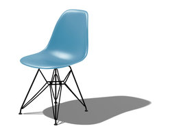 Herman Miller - Herman Miller Eames Molded Plastic Side Chair - A virtual work of art, this iconic chair from the design dream team of Charles and Ray Eames will have you sitting pretty, not to mention comfortably. Perhaps the most celebrated (and imitated) designs of the 20th century, it lends a playful presence wherever it sits.