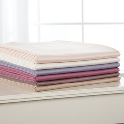 La Rochelle - La Rochelle 500 Thread Count Supima Cotton Sheet Set - 71382 - Shop for Sheets from Hayneedle.com! Surround yourself in luxury with the La Rochelle 500 Thread Count Supima Sheet Set. Available in twin full queen king and California king sizes this premium 500-thread count sheet set is made from soft durable 100% supima cotton fabric and is machine washable for easy care. Supima has a long fiber that provides a smoother feel than most types of cotton. This set includes a fitted sheet flat sheet and - depending on the size you choose - one or two matching pillowcases. The flat sheet features a four-inch hem with an elegant hem roll for a classic elegant flair. Able to accommodate up to a 20-inch deep mattress the fitted sheet has elastic sewn in all around for a secure fit. Pillowcases are oversized with a four-inch cuff and lovely hem roll detailing. This sheet set comes in a variety of color options.About CGG Home FashionsWhether you are shopping at Bloomingdale's or relaxing at a premier resort you are sure to find and appreciate CGG Home Fashions products. For over 20 years the company has been offering a broad selection of luxury linens high thread count sheets duvet covers pillows down and synthetic comforters drapes and table linens. CGG's acclaimed Belle Epoque collection is the epitome of elegance with styles ranging from traditional to contemporary. With offices and a warehouse in Yonkers New York and a showroom on New York's Fifth Avenue CGG is at the epicenter of textile design and innovation.