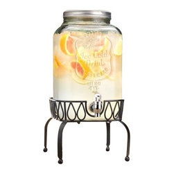 Home Essentials - Refreshing Ice Cold Mason Dispenser on Rack - At the beach or on the front porch, our Mason-jar inspired collection continues the American tradition of casual and stylish entertaining. Crafted from high quality, durable glass and fashioned into the shape of a mason jar complete with a traditional screw of lid. This dispenser is an established and classy way to serve refreshing drinks and cocktails. The stand elevates jar for an attractive presentation and easy dispersing indoors or out.  From juice to water, iced tea to lemonade, this high quality beverage dispenser will surely serve you well!   * Capacity: 2 gallons  * Acrylic spout ensures a smooth and efficient flow