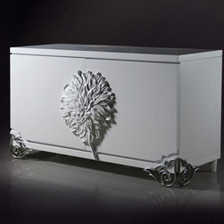 Emma White Lacquer Modern Buffet - This buffet is a fusion of styles that includes modern and midcentury influences, reflected in sleek lines & White high gloss lacquer finish, elegant zinc alloy legs, and floral emblem in middle.