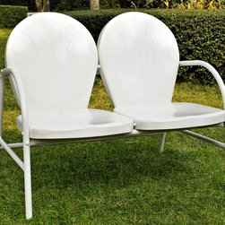 Crosley Furniture - Metal Loveseat in White - UV resistant. Warranty: 90 days. Made from steel. Non-Toxic powder coated finish. Assembly required. 41.13 in. W x 29.5 in. D x 34.5 in. H (29 lbs.)Relax outside for hours on our nostalgically inspired Griffith metal outdoor furniture. Kick back while you reminisce in this sturdy steel loveseat, designed to withstand the hottest of summer days and other harsh conditions. The loveseats non-toxic, powder-coated finish is available in various colors to complement your outdoor accessories.
