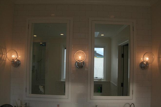 Beach Style Bathroom Mirrors by Core Development Group, Inc.